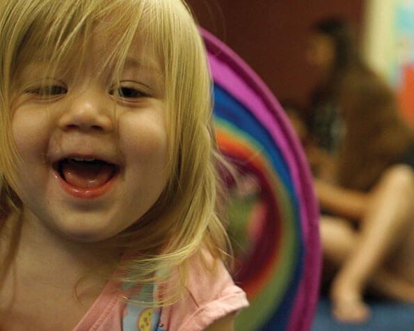 Girl smiling at Grove Kids.